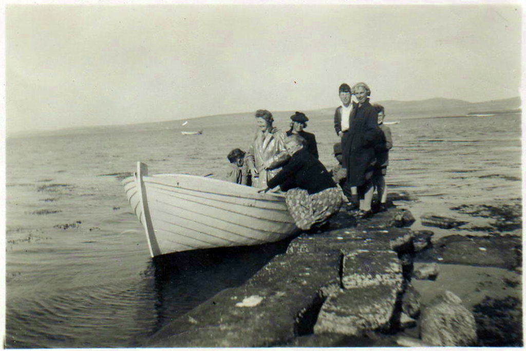 Homeward bound, the author (left) with his mother boarding Seagull at Quoys Noust
